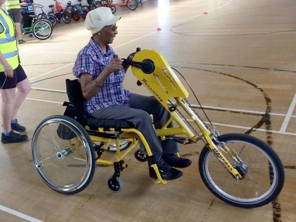 Eurel who has dementia gets the hand of her hand powered bike