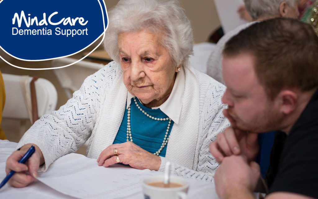 Support worker helping a lady with paperwork