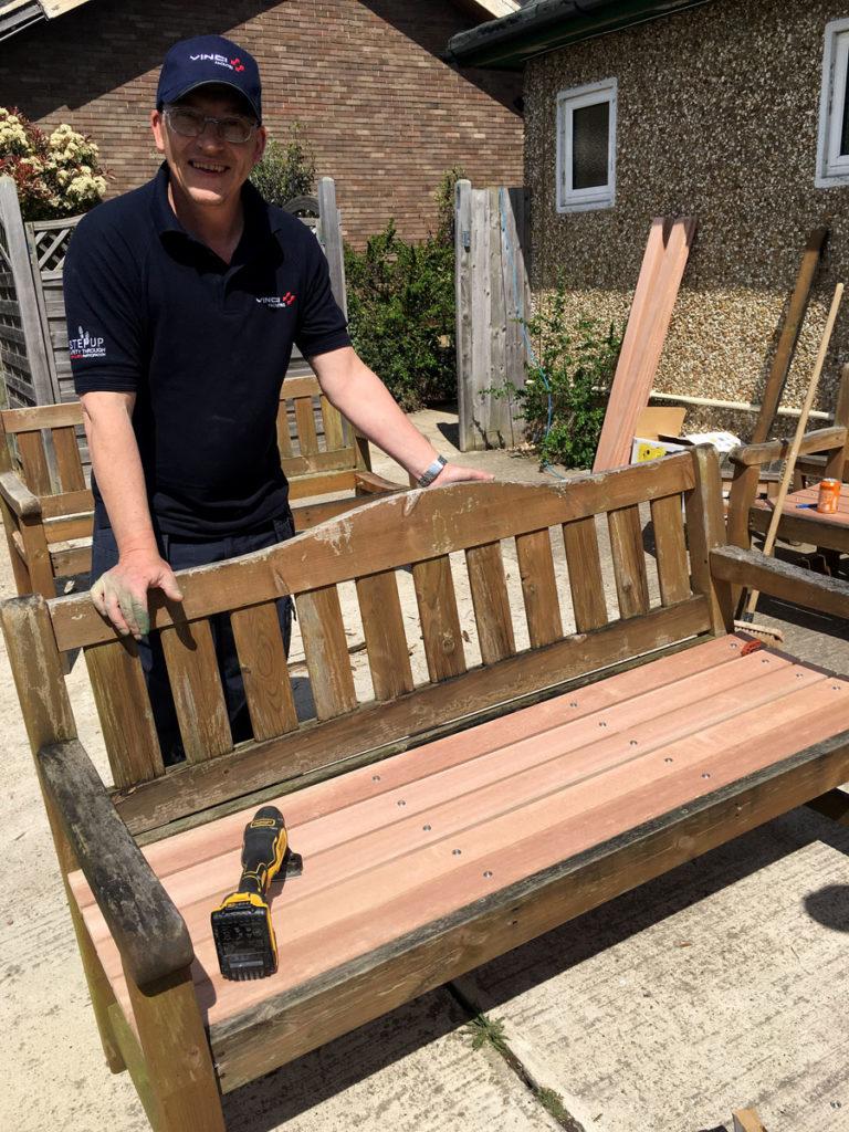 VINCI Facilities volunteers refurbishing the garden benches at Orpington MindCare Dementia Support