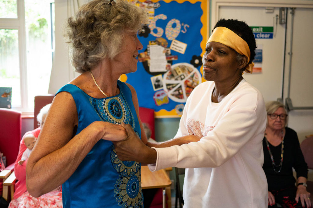 Care worker dancing with women with dementia