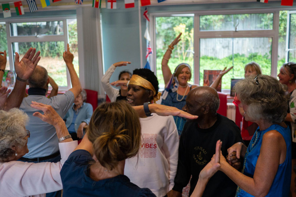 People with dementia, carers and care workers dancing to 70s classic, YMCA