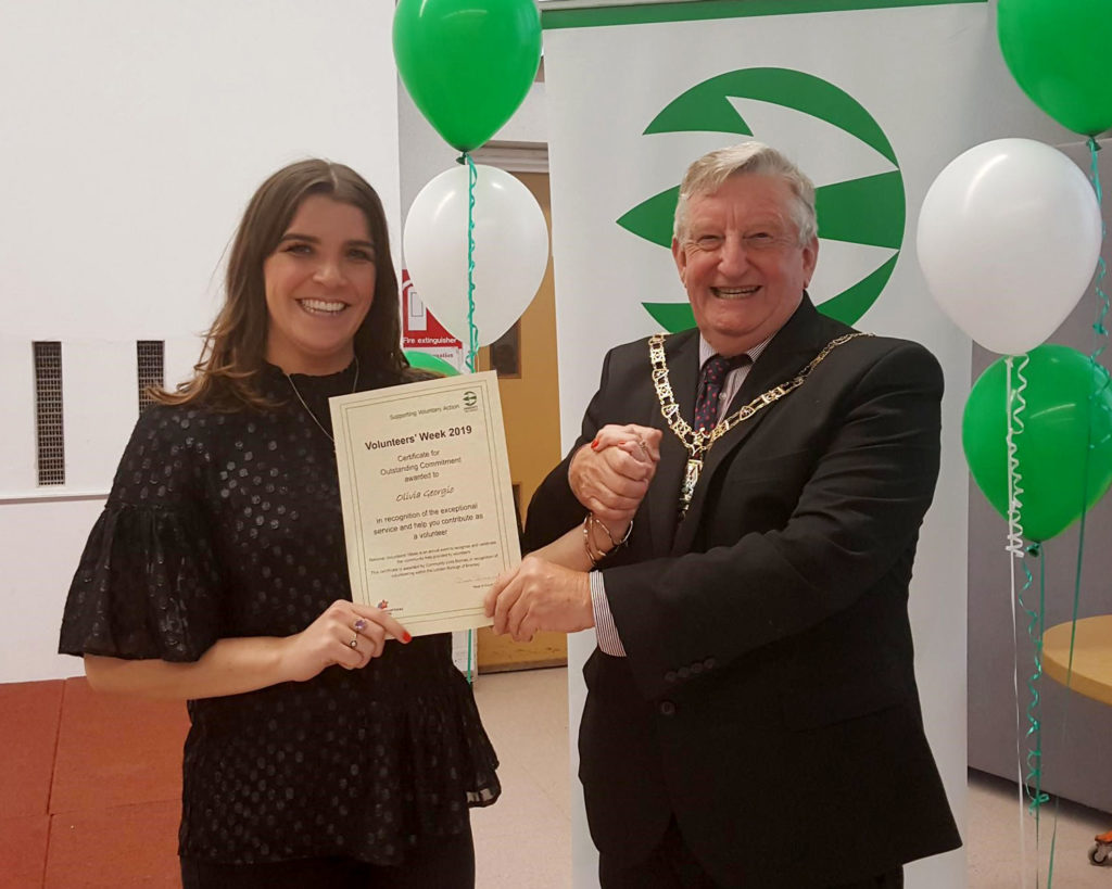 Olivia receiving her award from the Mayor of Bromley