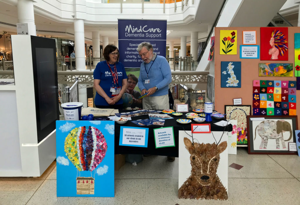 two volunteers at the MindCare Dementia Support stall at The Glades for Dementia Action Week 2019
