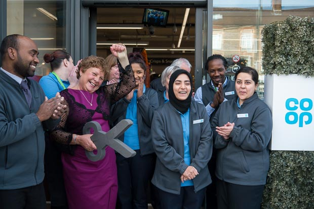 Jackie from MindCare Dementia Support cuts the ribbon and officially opens the new Co-op Eden Park, Beckenham store
