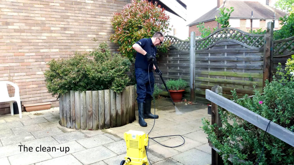 VINCI volunteer jet washing the garden at Orpington MindCare Dementia Support