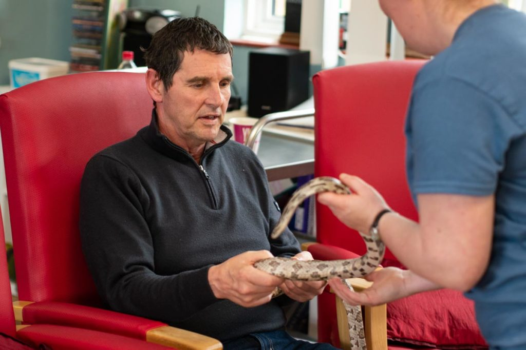 man with dementia handling a snake