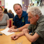 young female volunteer with care work and man with dementia