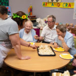 People with dementia and family carers being offered party food