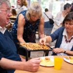 people enjoying party food