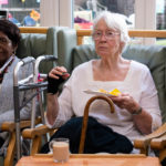 women with dementia enjoying the dementia centre party and food