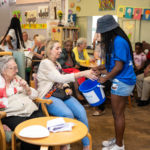 People picking winning raffle tickets for dementia fundraising prize competition