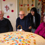 People living with dementia playing car word game and reminiscing